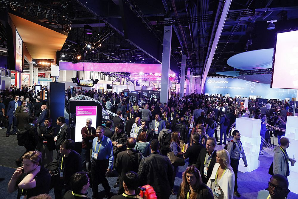 Attendees explore the show floor on CES opening day