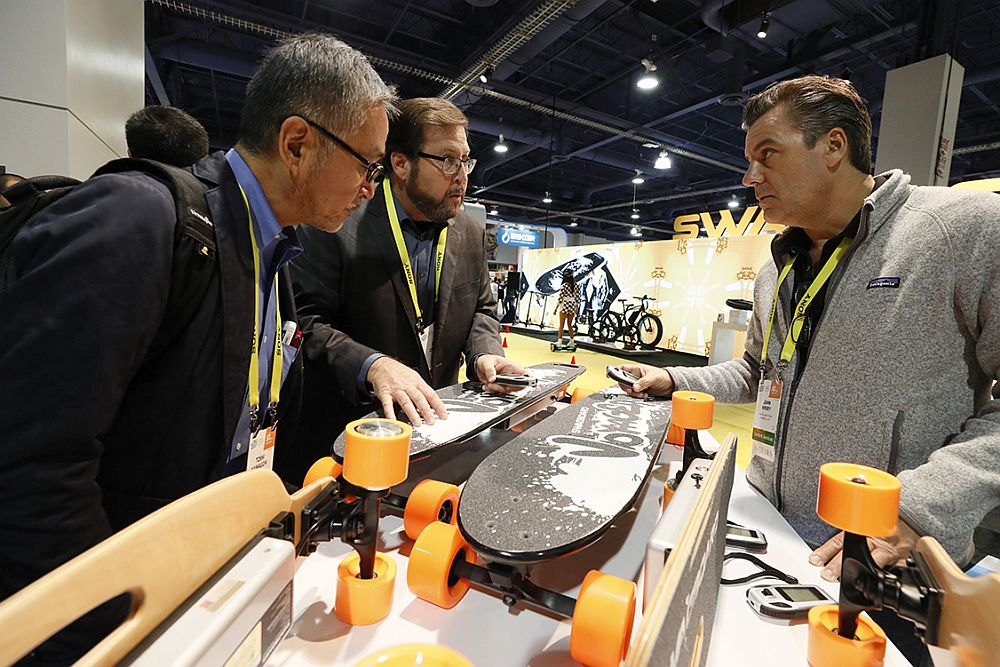Exhibitors and attendees interact at CES 2017